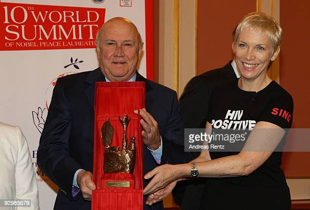 Former South African leader Frederik Willem de Klerk hands over the Peace award to musician Annie Lennox on the second day of the 10th World Summit...