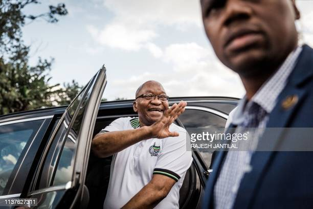 Former South African President and former president of the ruling party African National Congress Jacob Zuma waves to supporters as he arrives for a...