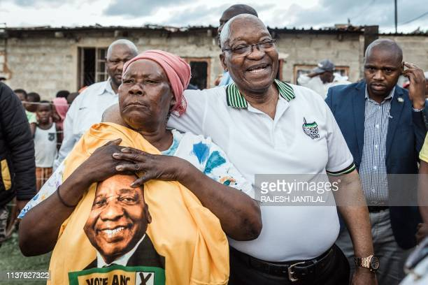 Former South African President and former president of the ruling party African National Congress Jacob Zuma is held tightly by ANC supporter Maria...