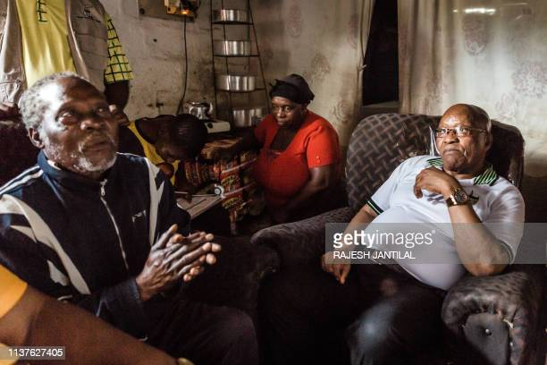 Former South African President and former president of the ruling party African National Congress Jacob Zuma meets residents during a door to door...