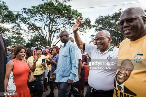 Former South African President and former president of the ruling party, the African National Congress Jacob Zuma waves to supporters during a short...