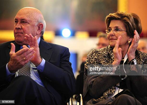 Former South African president and Nobel laureate Frederik Willem De Klerk and his wife Elita Georgiades applaud during the prize ceremony of British...