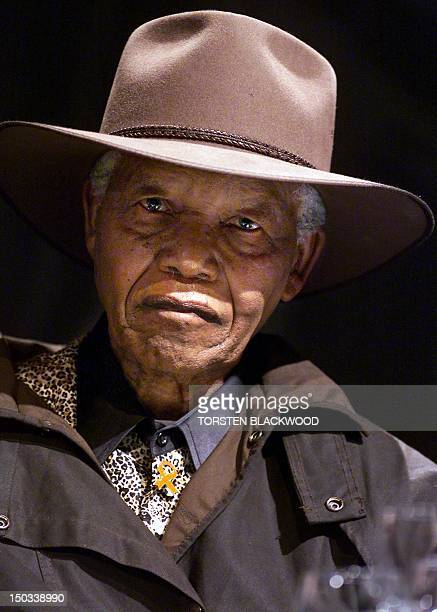 Former South African president and Nobel Peace laureate Nelson Mandela wears an Akubra hat and a tradition oilskin coat during the inaugural World...