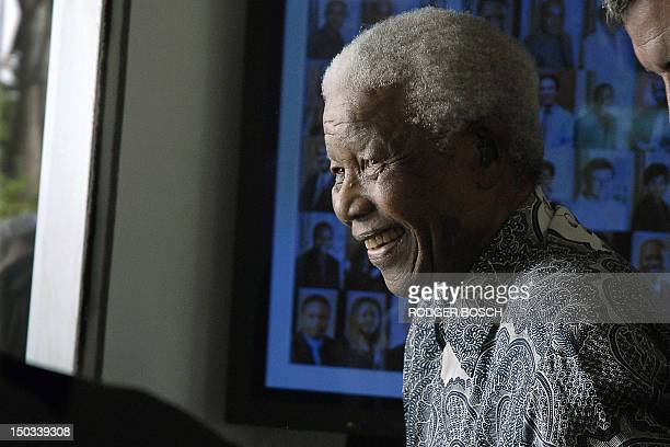 Former South African president and Nobel peace prize laureate Nelson Mandela joins guests at his home in Cape Town on August 20 2008 to celebrate his...