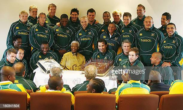 Former South African president and Nobel peace prize laureate Nelson Mandela receives his 90th birthday greetings from the South African rugby and...