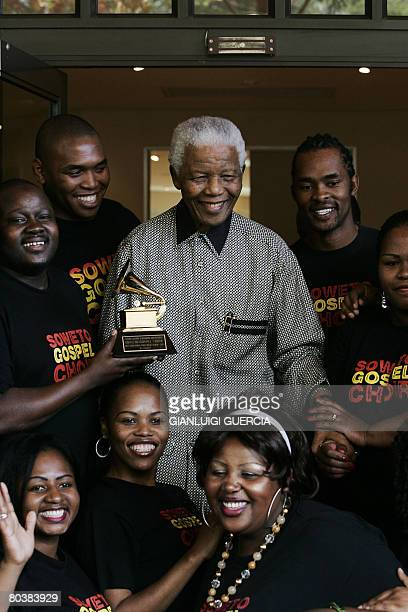 Former South African president and Nobel peace prize laureate Nelson Mandela poses on March 26 2008 with the Soweto Gospel Choir in the Mandela...