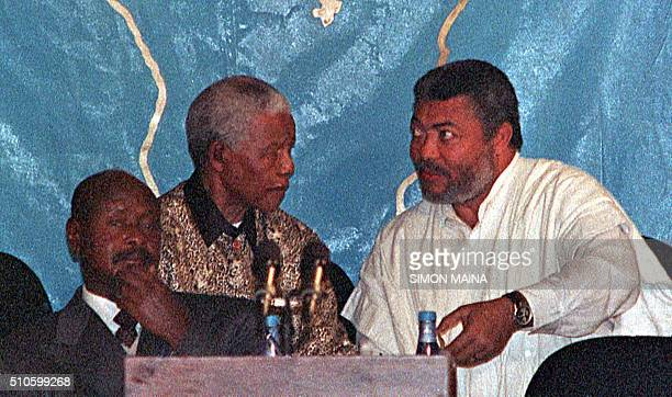 Former South African president and the peace facilitator for the Burundi peace talks Nelson Mandela listens to Ghananian president Jerry Rawlings as...