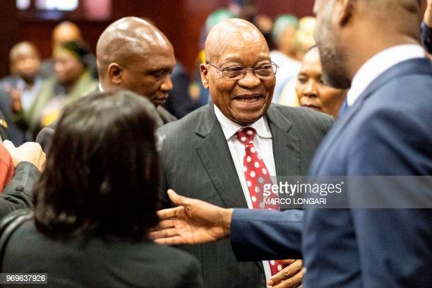 Former South African President Jacob Zuma greets his team and smile at the end of the hearing at the Durban Magistrate Court in Durban on June 8 2018...