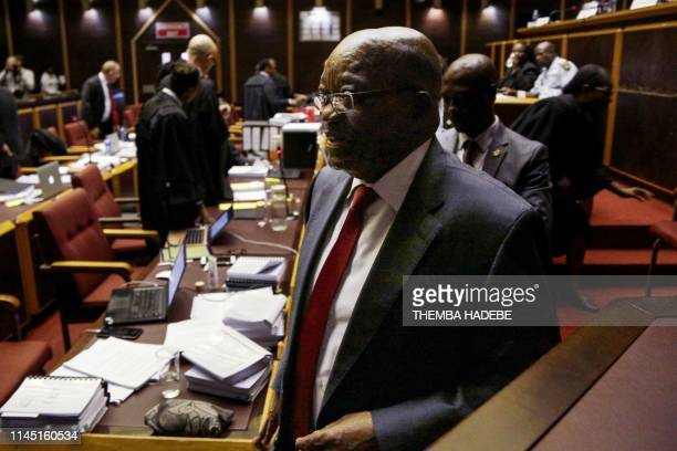 Former South African President Jacob Zuma leaves the court room for a break in the High Court in Pietermaritzburg, on May 20, 2019 during his trial...