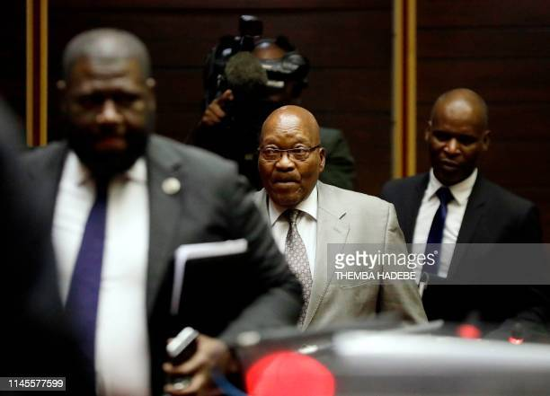 Former South African President Jacob Zuma looks on as he attends his trial for alledged corruption in the High Court in Pietermaritzburg, on May 23,...
