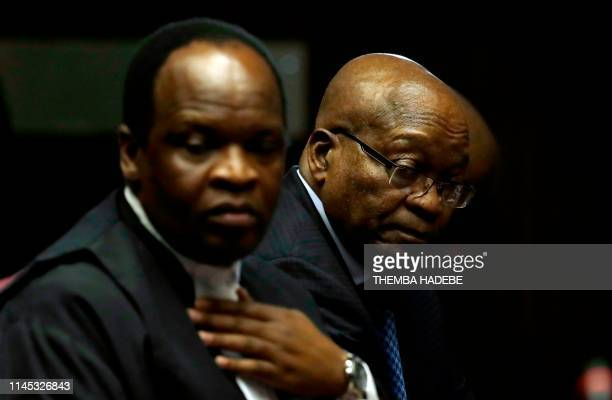 Former South African President Jacob Zuma next to his lawyer Muzi Sikhakhane attends his trial for alledged corruption in the High Court in...