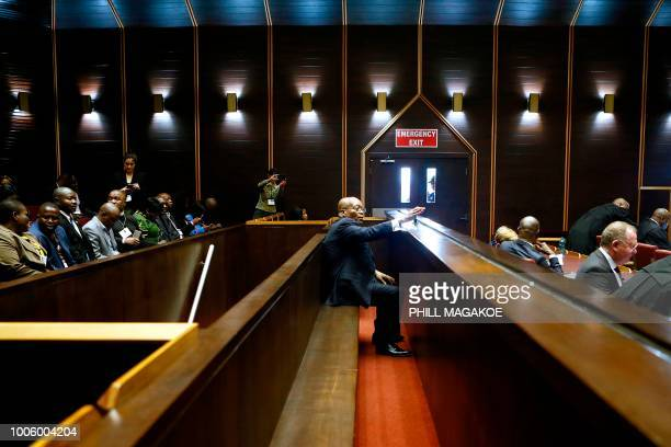 Former South African president Jacob Zuma sits in the dock of the High Court of Pietermaritzburg on July 27, 2018 for his hearing over 16 corruption...