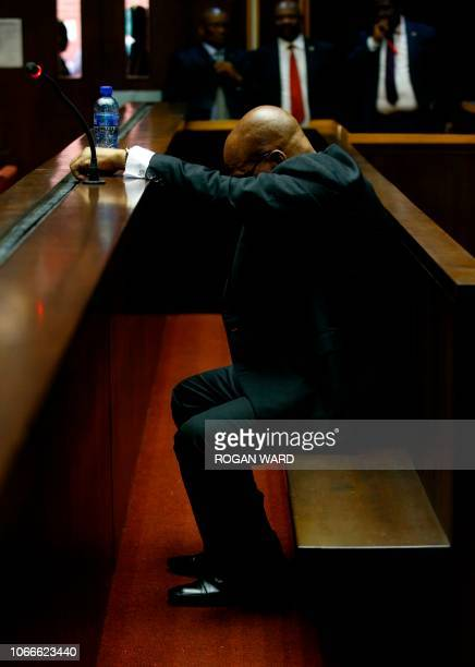 Former South African President Jacob Zuma waits ahead of his court hearing in Pietermaritzburg, on November 30, 2018. - Zuma who was forced to resign...