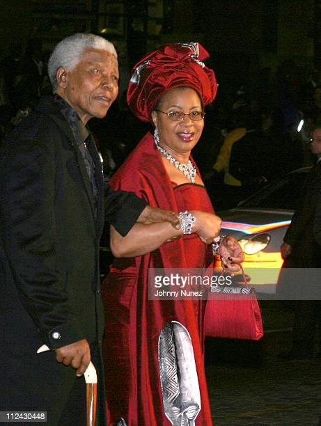 Former South African President Nelson Mandela and his wife Graca Machel arrive for Nelson Mandela's 85th birthday celebration