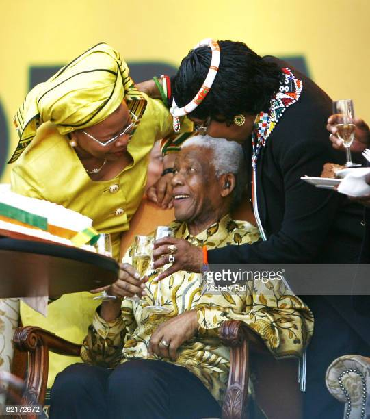 Former South African President Nelson Mandela flanked by his former wife Winnie Mandela and current wife Graca Machel attend the ANC Madiba 90th...