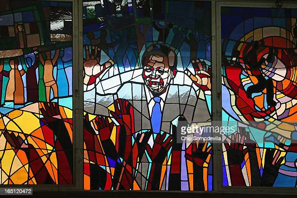 Former South African President Nelson Mandela is depicted in a stained glass window during Easter services at Regina Mundi Catholic Church in the...