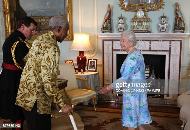 Former South African president Nelson Mandela meets Britain's Queen Elizabeth II at Buckingham Palace in central London on June 25 2008 Nelson...