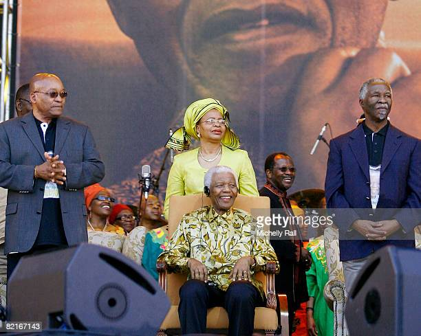Former South African President Nelson Mandela overlooked by wife Graca Machel and flanked by President Thabo Mbeki and ANC President Jacob Zuma...