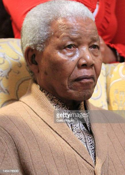 Former South African president Nelson Mandela receives the African Nation Congress' centenary torch at his home on May 30 2012 in Qunu South Africa...