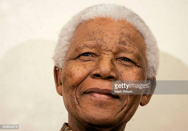 Former South African President Nelson Mandela smiles before speaking at the Brookings Intitution May 16, 2005 in Washington, D.C. Mandela talked...
