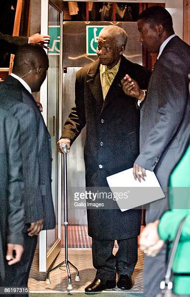 Former South African president Nelson Mandela steps out of an elevator as he makes a surprise appearance at the University of Pretoria on April 24...