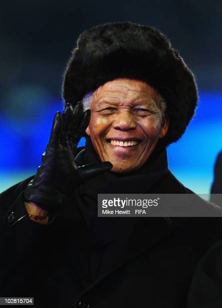 Former South African President Nelson Mandela waves during the closing ceremony before the 2010 FIFA World Cup South Africa Final match between...