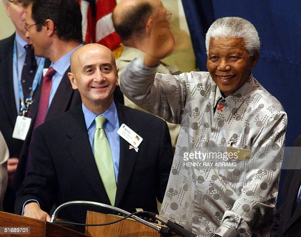 Former South African President Nelson Mandela waves from the bell podium of the New York Stock Exchange before ringing the opening bell 09 May 2002...