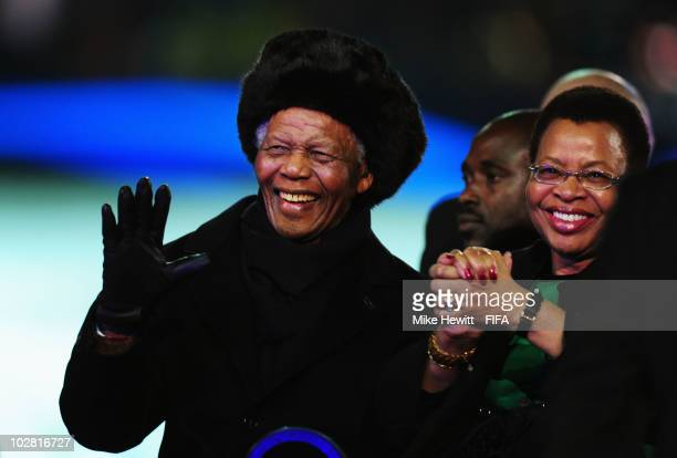 Former South African President Nelson Mandela waves next to his wife Graca Machel during the closing ceremony before the 2010 FIFA World Cup South...