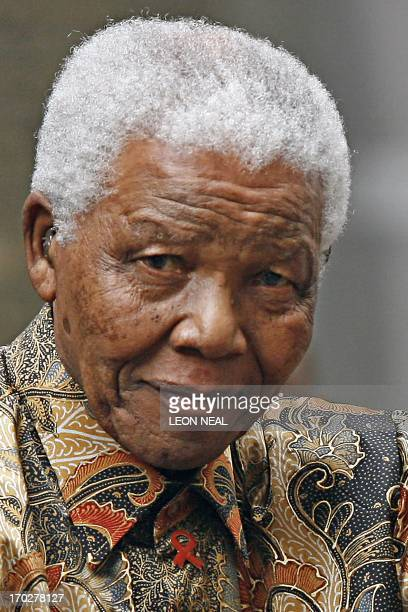 Former South African President Nelson Mandela waves to the media as he arrives outside 10 Downing Street in central London 28 August 2007 for a...