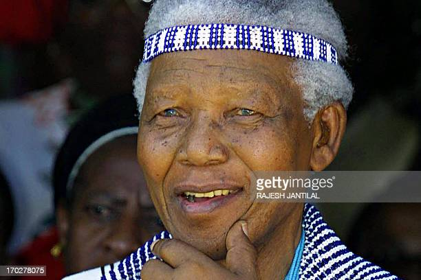 Former South African President Nelson Mandela wearing traditional Xhosa dress as a member of the Tembu Royal family attends the wedding of his great...