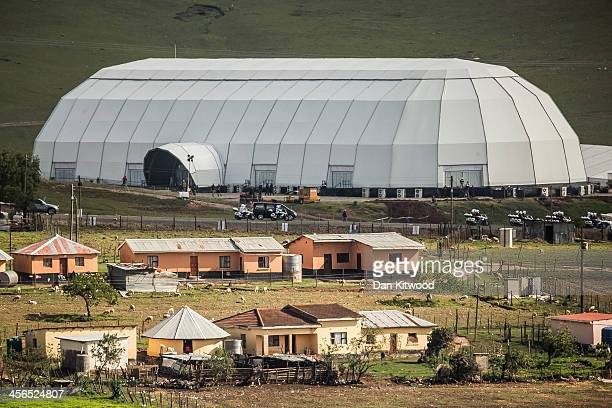 Former South African President Nelson Mandela's funeral cortege arrives at his familily's home town of Qunu on December 14 2013 in Qunu South Africa...