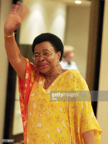Former South African president Nelson Mandela's wife Graca Machel waves 03 October 2007 as she enters the venue of a joint press conference with...