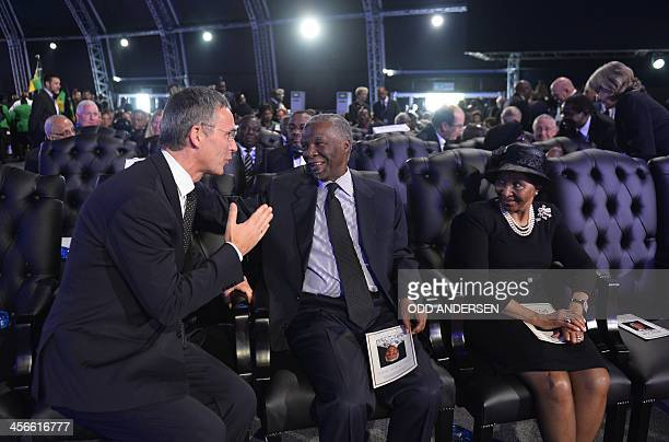 Former South African President Thabo Mbeki listens to Norway's former Pime Minister Jens Stoltenberg attends the funeral ceremony of South African...