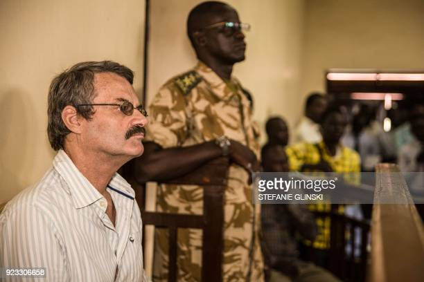 TOPSHOT A former South African soldier William Endley who was hired in 2016 to advise former vice president and rebel leader Riek Machar looks on as...