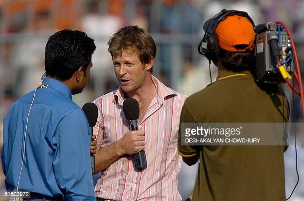 Former South African Test cricketer Jonty Rhodes gives a television interview during an interval on the third day of the second Test match between...