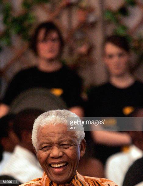 Former South Africa's President Nelson Mandela grins as former Zambia's President Kenneth Kaunda unseen makes a joke during his 90th birthday...