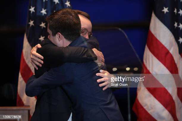 Former South Bend Indiana Mayor Pete Buttigieg hugs his husband Chasten after announcing he was ending his campaign to be the Democratic nominee for...
