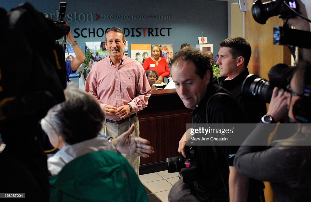 Former South Carolina Gov. Mark Sanford (C) is surrounded by media as he waits to enter the polling place to cast his vote in the special election runoff with Elizabeth Colbert Busch for a seat in the 1st Congressional District May 7, 2013 in Charleston, South Carolina. Voters are deciding between Sanford, a Republican seeking a political comeback after an extramarital affair and Busch, a Democratic businesswoman and the sister of comedian of Stephen Colbert.