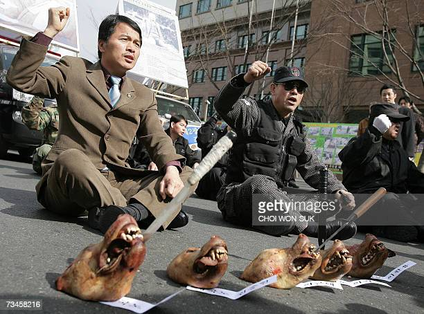 Former South Korean army commandoes stage an antiJapanese protest near the Japanese embassy in Seoul 01 March 2007 with knives tucked in the mouths...