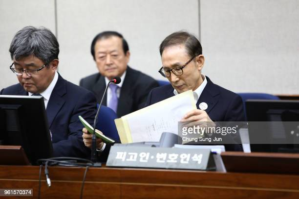 Former South Korean President Lee MyungBak appears for his first trial at the Seoul Central District Court on May 23 2018 in Seoul South Korea Lee...