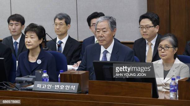 Former South Korean President Park Geun-hye and her longtime friend Choi Soon-sil attend the trial at the Seoul Central District Court in Seoul on...