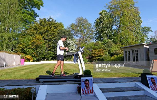 Former Southampton FC player and current club ambassador Francis Benali runs the distance of a marathon on a treadmill in his garden at his home as...