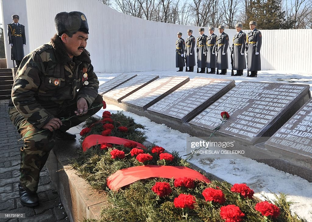 A former Soviet Army seviceman lays flowers at a monument to those Soviet soldiers born in Kyrgyzstan who was killed in Afghanistan while fighting against the Afghan rebels in the 1980s in the Kyrgyztan's capital Bishkek on February 15, 2013. The ex-Soviet nation of Kyrgyzstan marked today the 24th anniversary of the Soviet troops withdrawal from Afghanistan.