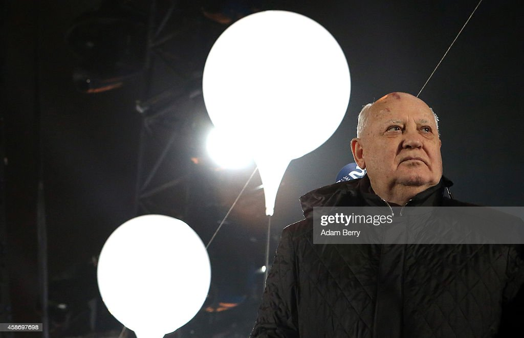Former Soviet leader Mikhail Gorbachev attends celebrations for the 25th anniversary of the fall of the Berlin Wall at the Brandenburg Gate on November 9, 2014 in Berlin, Germany. The city of Berlin is commemorating the 25th anniversary of the fall of the Berlin Wall from November 7-9 with an installation of 6,800 lamps coupled with illuminated balloons along a 15km route where the Wall once ran and divided the city into capitalist West and communist East. The fall of the Wall on November 9, 1989, was among the most powerful symbols of the revolutions that swept through the communist countries of Eastern Europe and heralded the end of the Cold War. Built by the communist authorities of East Germany in 1961, the Wall prevented East Germans from fleeing west and was equipped with guard towers and deadly traps.