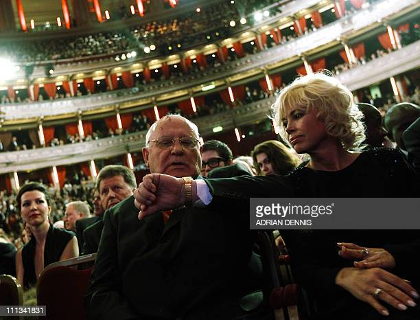 Former Soviet leader Mikhail Gorbachev sits beside his daughter Irina Virganskaya while awaiting the start of a gala a celebration of his 80th...