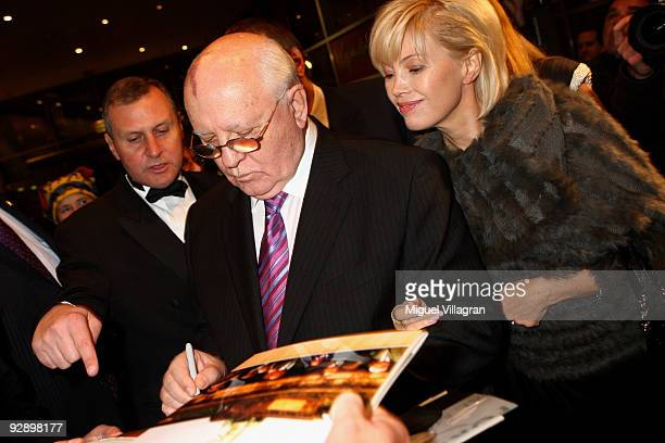 Former Soviet leader Mikhail Gorbatchev signs autographs as he stand next to his daughter Irina Virganskaya and the Russian ambassador in Germany...