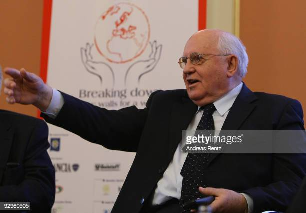 Former Soviet President Mikhail Gorbachev gestures during his speech at the 10th World Summit of Nobel Peace Laureates at Berlin town hall on...