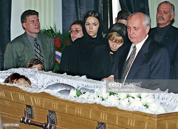 Former Soviet President Mikhail Gorbachev stands with daughter Irina and granddaughter Krenia as they grieve at the coffin of Raisa Gorbachev at...