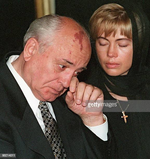Former Soviet president Mikhail Gorbachev wipes his tears as his daughter Irina gestures during a ceremony of paying last respects to late Raisa...