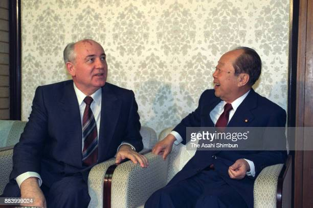 Former Soviet Union President Mikhail Gorbachev and Japanese Prime Minister Kiichi Miyazawa talk during their meeting at the prime minister's...